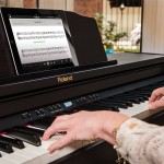 Woman playing Roland Digital piano